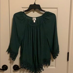 A emerald green blouse.
